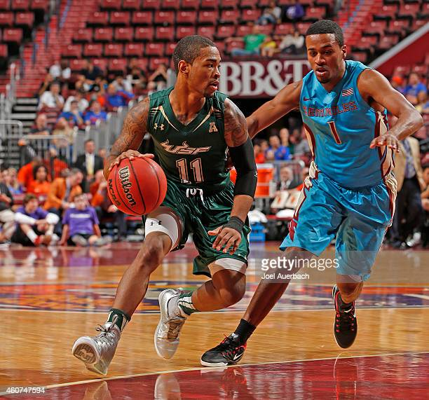 Devon Bookert of the Florida State Seminoles defends against Anthony Collins of the South Florida Bulls during the MetroPCS Orange Bowl Basketball...