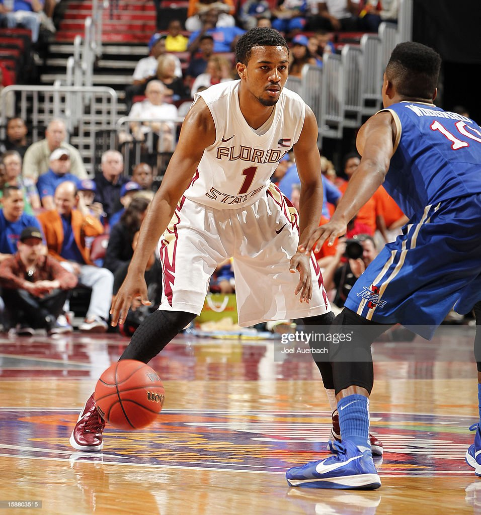 Devon Bookert #1 of the Florida State Seminoles dribbles the ball against the Tulsa Golden Hurricane at the MetroPCS Orange Bowl Basketball Classic on December 29, 2012 at the BB&T Center in Sunrise, Florida. The Seminoles defeated the Golden Hurricane 82-63