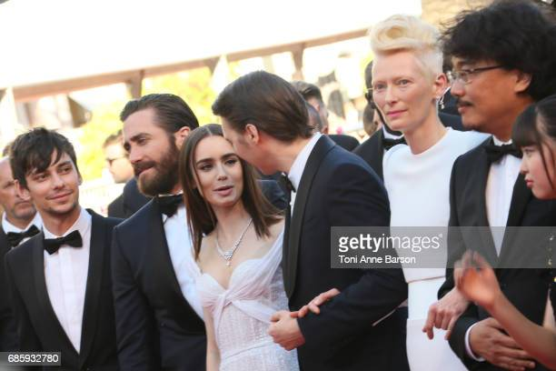 Devon Bostic Jake Gyllenhaal Lily Collins Paul Dano and Tilda Swinton director Bong JoonHo attend the 'Okja' screening during the 70th annual Cannes...
