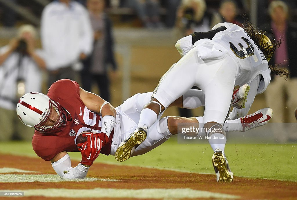 Devon Cajuste #89 of the Stanford Cardinal's dives into the endzone for a touchdown against the UCLA Bruins during the second quarter of an NCAA football game at Stanford Stadium on October 15, 2015 in Stanford, California.