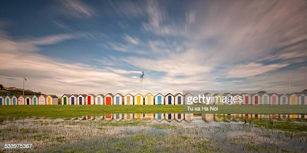 devon colorful beach huts - devon stock pictures, royalty-free photos & images