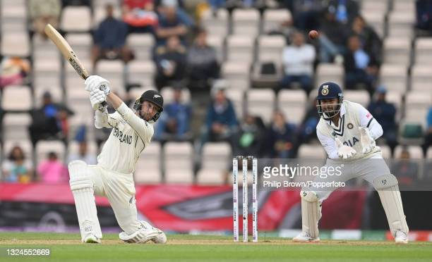 Devon Conway of New Zealand hits a four as Rishabh Pant looks on during Day 3 of the ICC World Test Championship Final between India and New Zealand...