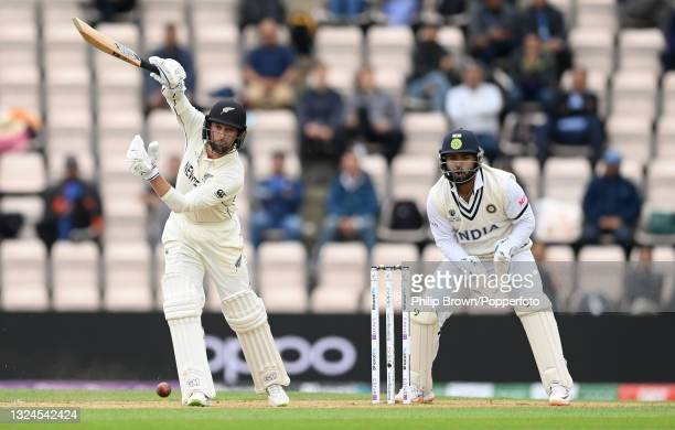 Devon Conway of New Zealand hits out watched by Rishabh Pant of India during Day 3 of the ICC World Test Championship Final between India and New...