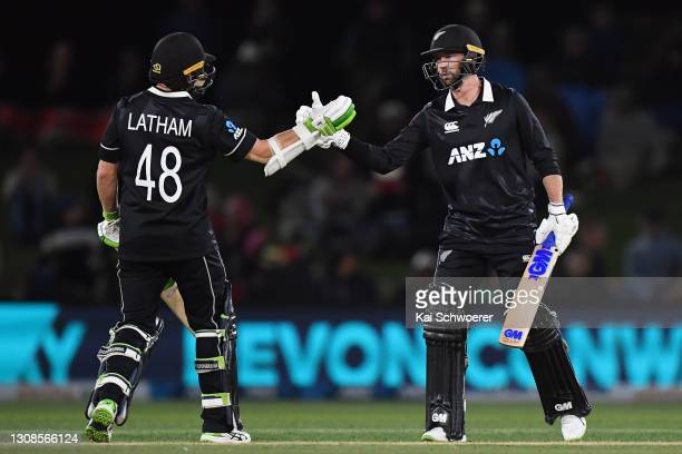 Devon Conway of New Zealand is congratulated by Tom Latham of New Zealand after scoring a half century during game two of the One Day International...