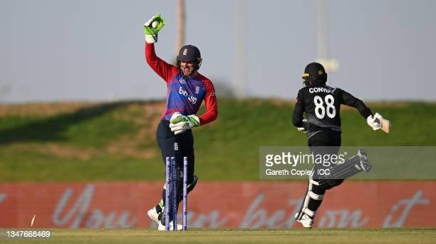 Devon Conway of New Zealand is run out by Jos Buttler of England during the England and New Zealand warm Up Match prior to the ICC Men's T20 World...