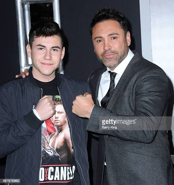 Devon De La Hoya and father boxer Oscar De La Hoya attend the Premiere Of Warner Bros Pictures' 'Creed' at the Regency Village Theatre on November 19...