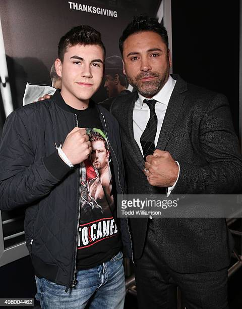 Devon De La Hoya and father Oscar De La Hoya attend the premiere Of Warner Bros Pictures' Creed at Regency Village Theatre on November 19 2015 in...