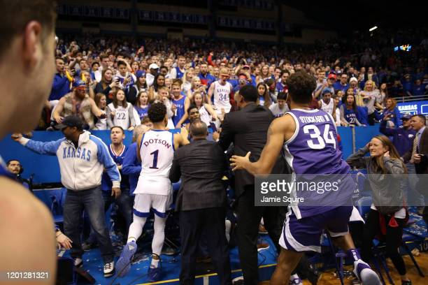 Devon Dotson of the Kansas Jayhawks and Levi Stockard III of the Kansas State Wildcats participate in a brawl after the game at Allen Fieldhouse on...