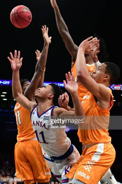 Devon Dotson of the Kansas Jayhawks attempts a shot during the first half of the game against Tennessee Volunteers at the NIT Season TipOff...