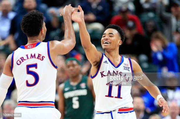 Devon Dotson of the Kansas Jayhawks celebrates with Quentin Grimes against the Michigan State Spartans during the State Farm Champions Classic at...