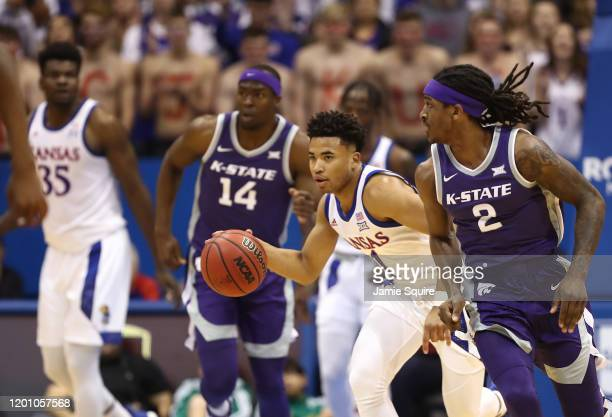 Devon Dotson of the Kansas Jayhawks controls the ball during the game against the Kansas State Wildcats at Allen Fieldhouse on January 21 2020 in...