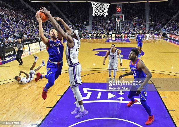 Devon Dotson of the Kansas Jayhawks drives in for a basket against Makol Mawien of the Kansas State Wildcats during the second half at Bramlage...