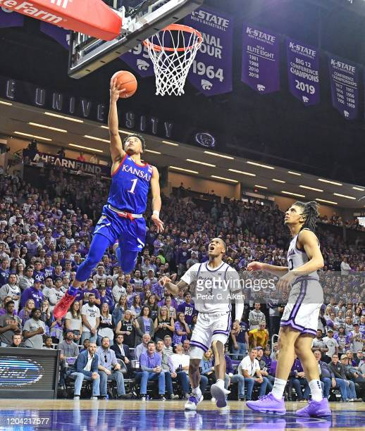 Devon Dotson of the Kansas Jayhawks drives in for a basket during the first half against the Kansas State Wildcats at Bramlage Coliseum on February...
