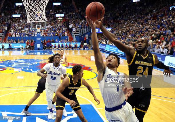 Devon Dotson of the Kansas Jayhawks drives toward the basket as Josh Thomas of the Milwaukee Panthers defends during the game at Allen Fieldhouse on...