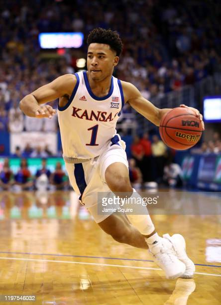 Devon Dotson of the Kansas Jayhawks drives upcourt during the game against the West Virginia Mountaineers at Allen Fieldhouse on January 04, 2020 in...