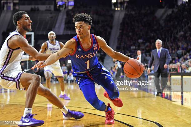 Devon Dotson of the Kansas Jayhawks drives with the ball during the first half against Antonio Gordon of the Kansas State Wildcats at Bramlage...