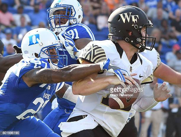 DeVon Edwards of the Duke Blue Devils strips the ball away from quarterback John Wolford of the Wake Forest Demon Deacons during their game at...