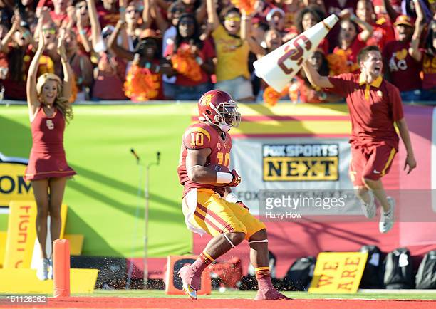 De'Von Flournoy of the USC Trojans crosses the end zone to score a touchdown against the Hawaii Warriors during the first quarter at Los Angeles...
