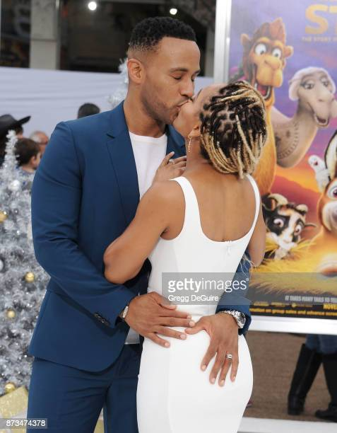 DeVon Franklin and Meagan Good arrive at the premiere of Columbia Pictures' 'The Star' at Regency Village Theatre on November 12 2017 in Westwood...