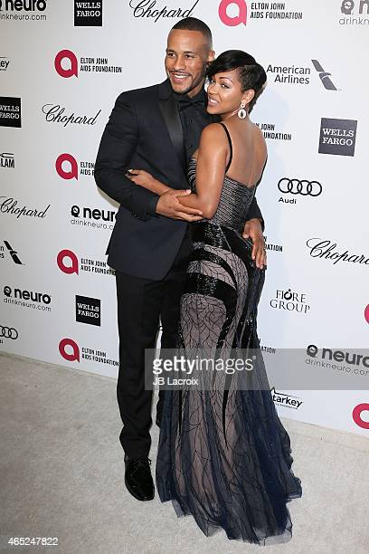 Devon Franklin and Meagan Good attend the 23rd Annual Elton John AIDS Foundation Academy Awards Viewing Party on February 22 2015 in West Hollywood...
