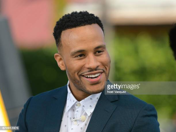 Devon Franklin visits 'Extra' at Universal Studios Hollywood on April 20 2017 in Universal City California