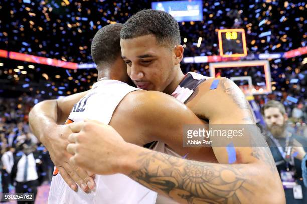 Devon Hall and Isaiah Wilkins of the Virginia Cavaliers celebrate after defeating the North Carolina Tar Heels 7163 during the championship game of...