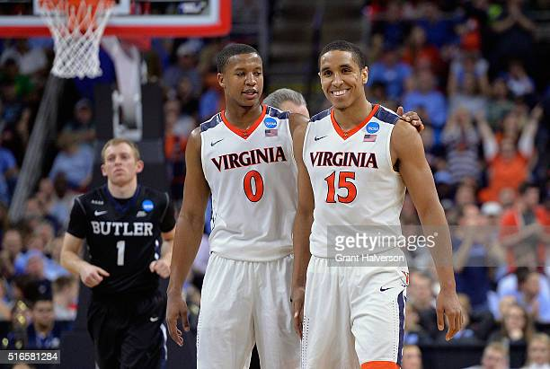 Devon Hall and Malcolm Brogdon of the Virginia Cavaliers celebrate their 7769 win over the Butler Bulldogs during the second round of the 2016 NCAA...