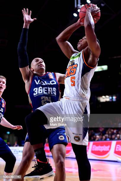 Devon Hall of the Taipans shoots for goal past Jacob Wiley of the Adelaide 36ers during the round seven NBL match between the Adelaide 36ers and the...