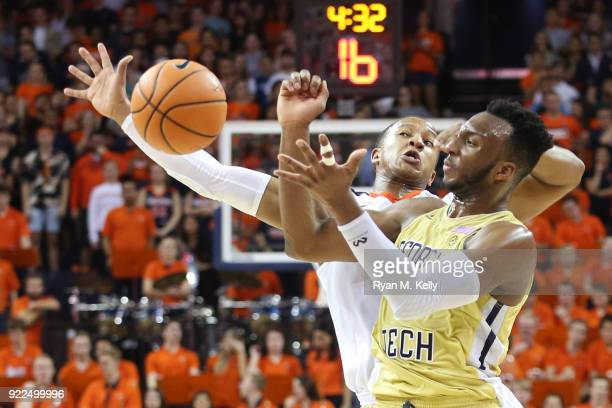 Devon Hall of the Virginia Cavaliers and Josh Okogie of the Georgia Tech Yellow Jackets reach for a loose ball in the first half during a game at...