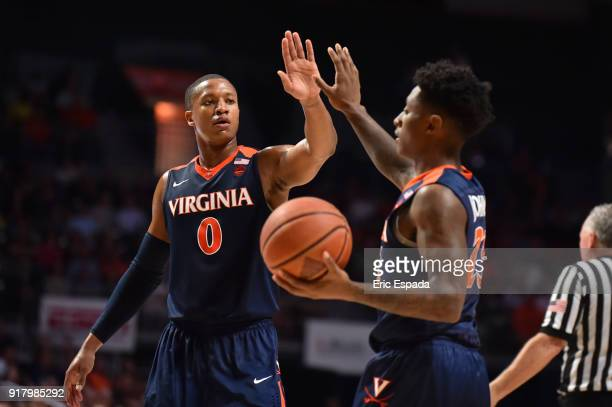 Devon Hall of the Virginia Cavaliers congratulates teammate Nigel Johnson after getting fouled during the first half of the game against the Miami...