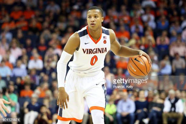Devon Hall of the Virginia Cavaliers dribbles in the first half during a game against the Georgia Tech Yellow Jackets at John Paul Jones Arena on...