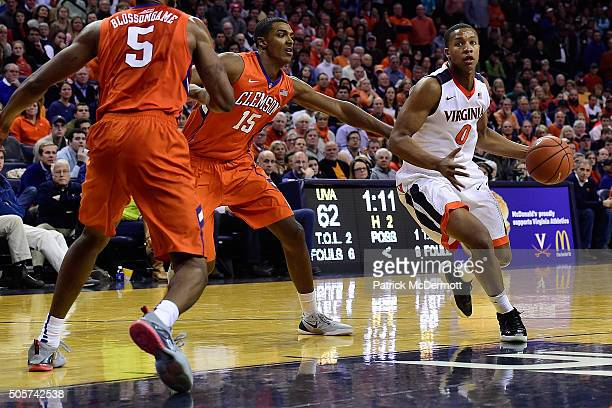 Devon Hall of the Virginia Cavaliers dribbles the ball past Donte Grantham of the Clemson Tigers in the second half during a game at John Paul Jones...