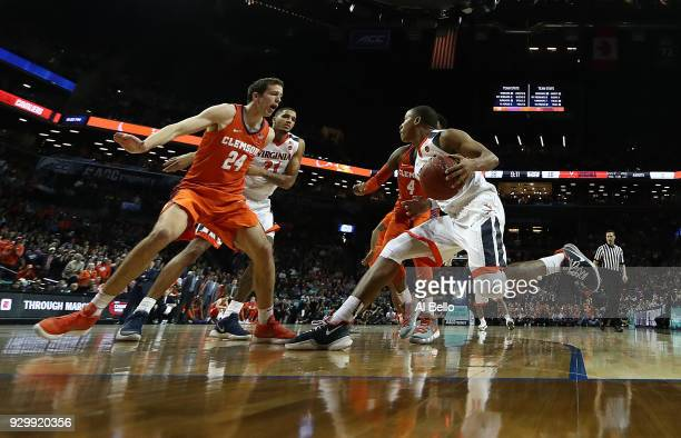 Devon Hall of the Virginia Cavaliers drives against David Skara of the Clemson Tigers during the semifinals of the ACC Men's Basketball Tournament at...