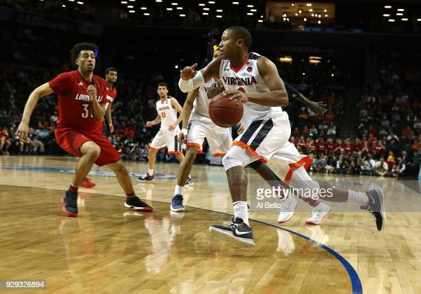 Devon Hall of the Virginia Cavaliers drives against the Louisville Cardinals during the quarterfinals of the ACC Men's Basketball Tournament at the...