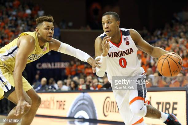 Devon Hall of the Virginia Cavaliers drives past Brandon Alston of the Georgia Tech Yellow Jackets in the second half during a game at John Paul...