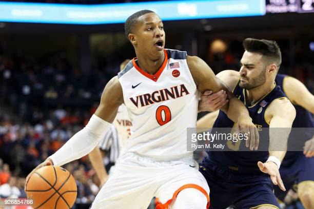 Devon Hall of the Virginia Cavaliers drives through Matt Farrell of the Notre Dame Fighting Irish in the first half during a game at John Paul Jones...