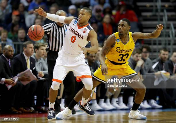 Devon Hall of the Virginia Cavaliers grabs a loose ball against Arkel Lamar of the UMBC Retrievers during the first round of the 2018 NCAA Men's...
