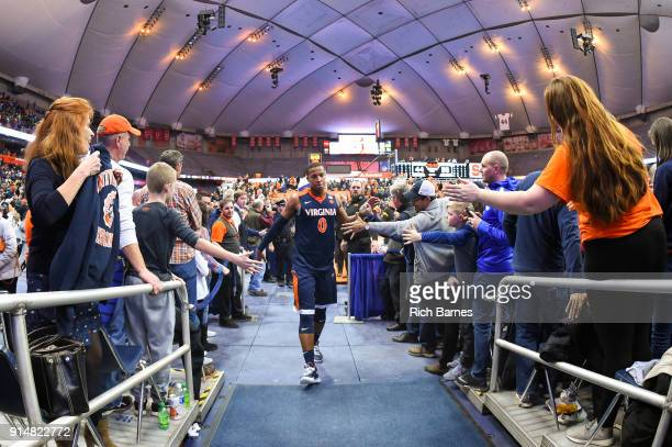 Devon Hall of the Virginia Cavaliers greets fans while leaving the court following the game against the Syracuse Orange at the Carrier Dome on...