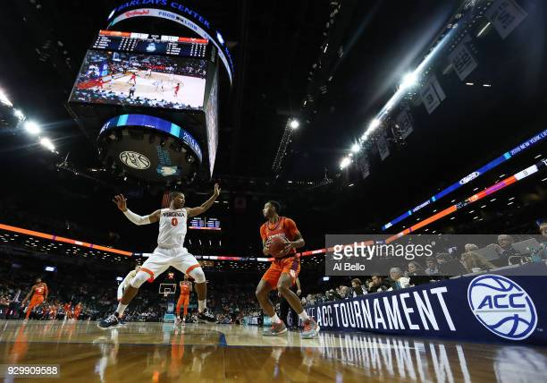 Devon Hall of the Virginia Cavaliers posts up against Marcquise Reed of the Clemson Tigers during the semifinals of the ACC Men's Basketball...