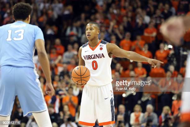 Devon Hall of the Virginia Cavaliers sets up a play in the second half during a game against the North Carolina Tar Heels at John Paul Jones Arena on...