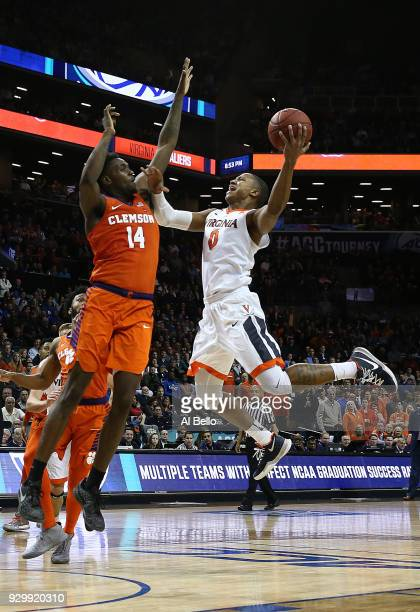 Devon Hall of the Virginia Cavaliers shoots against Elijah Thomas of the Clemson Tigers during the semifinals of the ACC Men's Basketball Tournament...
