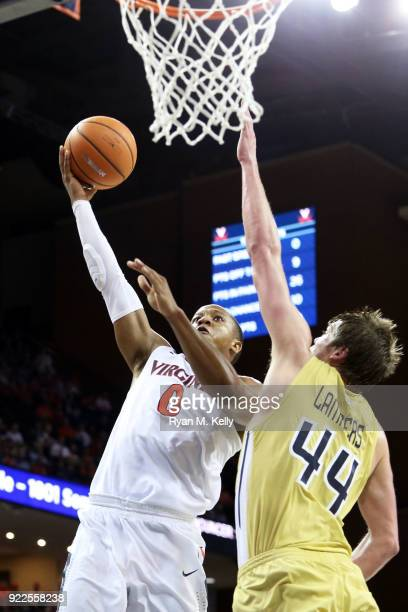Devon Hall of the Virginia Cavaliers shoots over Ben Lammers of the Georgia Tech Yellow Jackets in the second half during a game at John Paul Jones...