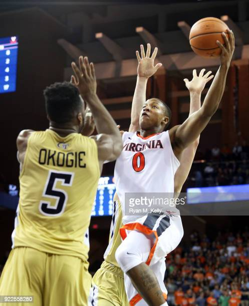 Devon Hall of the Virginia Cavaliers shoots over Josh Okogie of the Georgia Tech Yellow Jackets in the second half during a game at John Paul Jones...