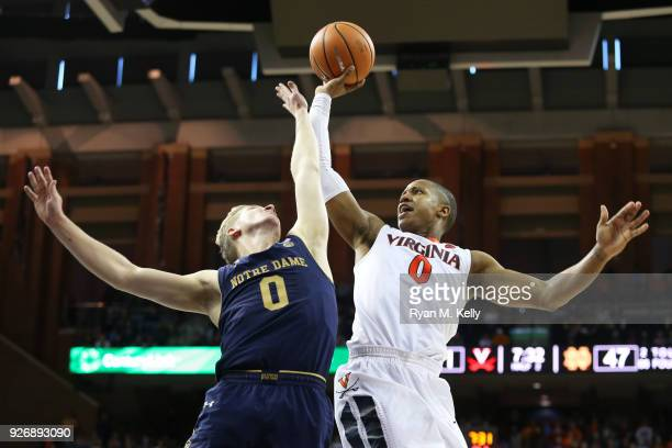 Devon Hall of the Virginia Cavaliers shoots over Rex Pflueger of the Notre Dame Fighting Irish in the second half during a game at John Paul Jones...