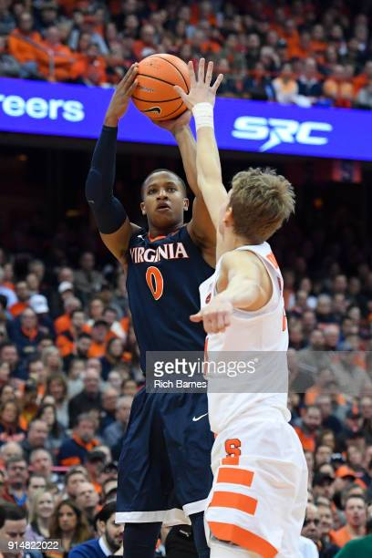 Devon Hall of the Virginia Cavaliers shoots the ball Marek Dolezaj of the Syracuse Orange during the first half at the Carrier Dome on February 3...