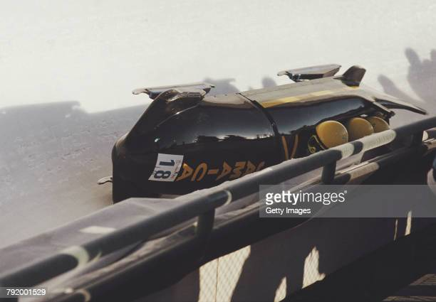 Devon Harris, Dudley Stokes, Michael White and Samuel Clayton of the Jamaica 1 crash out of the Four-man Bobsleigh competition on 28 February 1988...