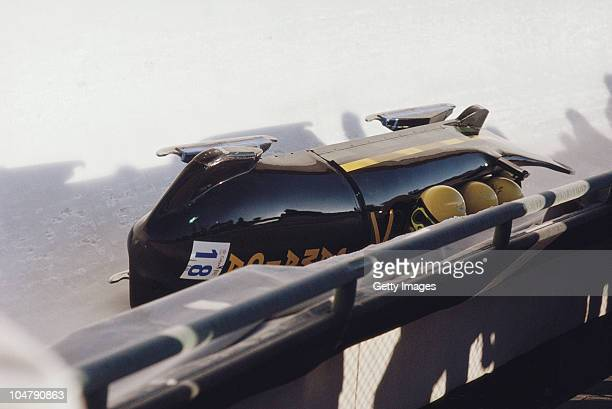 Devon Harris Dudley Stokes Michael White and Samuel Clayton of the Jamaican 4 man bobsled team crash out of the Bobsleigh Fours event on 28th...