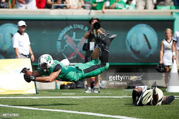 Devon Johnson of the Marshall Thundering Herd dives into the end zone for a 20yard touchdown reception in the first half against the Purdue...