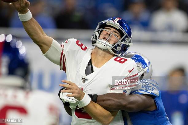 Devon Kennard of the Detroit Lions makes the hit on Daniel Jones of the New York Giants causing a fumble and touchdown recovery for the Detroit Lions...