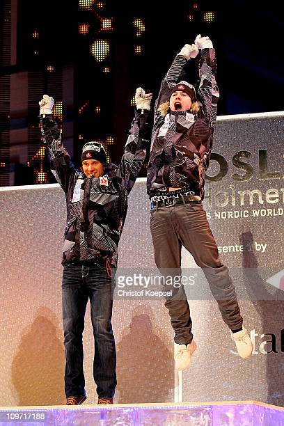 Devon Kershaw and Alex Harvey of Canada celebrate prior to receiving the gold medals won in the Men's Cross Country Team Sprint race during the FIS...